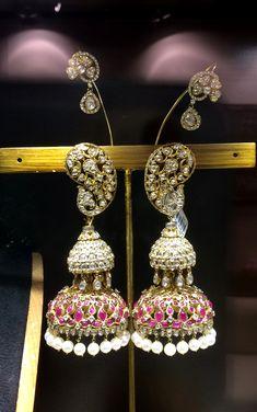 Traditional earcuffs by Birdhichand Ghanshyamdas jewellers with paisleymotifs ear cuffs...readlly???