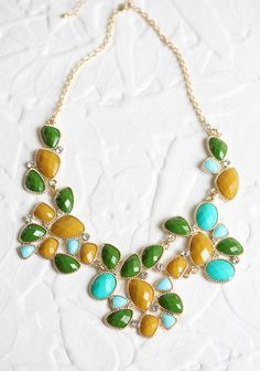 "Colors Of Spring Stone Necklace 25.99 at shopruche.com. Adorn your neck with the colors of spring. This golden hued necklace features shimmering green, blue, and mustard beads accented with sparkling rhinestone details.Chain approx. 20"" long, Pendant approx. 2"" long, ,"