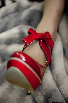 Red heels with a cute bow. LOVE!