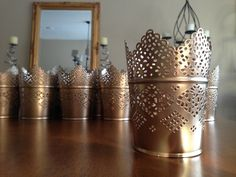 https://item2.tradesy.com/r/29b42081725f96a2a6407c5a3f4e870f/720/960/weddings/other/os/ikea-skurar-lace-candle-holders-painted-gold-543651.j...