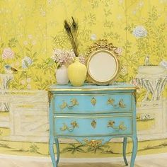 turquoise chest of drawers on yellow