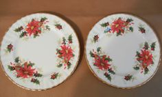 "Royal Albert salad plates in the ""Yuletide"" pattern made in 1996.  The earlier 1975 pattern was called 'Poinsettia' and was slightly different.  The gold edging on this stands out more and more red poinsettias with holly."