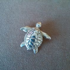 This sweet #Sea Turtle #pendant was lovingly #handcarved by #Tara Shelton and cast into #sterling silver. Price $165.00 CDN. See more of #artisan Tara Shelton's #jewelry #jewellery at #ArtisansAtWork/ #AAWGallery www.aawgallery.com and www.tarashelton.com Wax Carving, Sansa, Hand Carved, Turtle, Insects, Cute Animals, Artisan, Creatures, It Cast