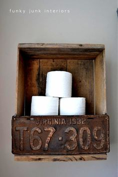 junk filled summer home decorating tour Crate and license plate toilet paper storage via Funky Junk Interiors. (A Pin-worthy toilet paper holder!)Crate and license plate toilet paper storage via Funky Junk Interiors. (A Pin-worthy toilet paper holder!