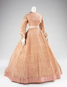 Evening dressvening dress Designer: Mme. Olympe (American, born France, 1830) Date: ca. 1865 Culture: American Medium: silk, mother-of-pearl