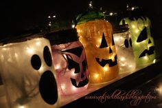 Halloween decorations I can actually afford! I think I might cry! Mason Jar luminaries with face template!!