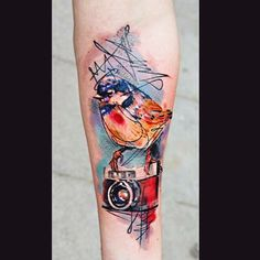 Very cool bird & camera tattoo by Chyba Ty Tattoo