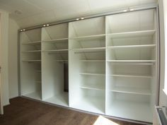 Slanted ceiling closet- shelving behind the hanging bars for out of season clothes