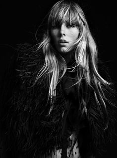 Hedi Slimane captures the latest Saint Laurent Paris advertisement with top model Edie Campbell joined for the black and white session by the one and only Beck.