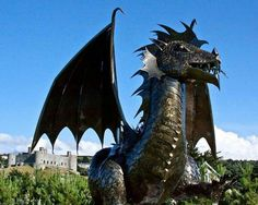 Dewi, the Welsh Dragon standing guard at Castle Harlech, Wales