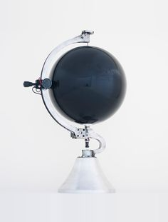 The Sound of the Earth: As a needle passes over this vinyl globe, by Japanese designerYuri Suzuki,it plays folk music and national anthems from around the world.    When the needle moves along its metal arc it plays sounds from the grooves cut into the sphere, much like a traditional vinyl record player.    Via Dezeen.
