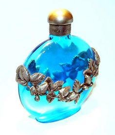 blue bottle with silver leaf