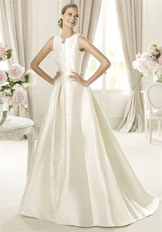 This wedding dress features delicate folds that give shape to the hem and the wonderful bateau neckline. Ubago from the Costura by Pronovias 2013 collection is a beautiful A-line wedding dress with delicate soutage embroidery. It is beaded and covered in delicate pleats and has square armholes that accentuate its exquisite elegance.  Silhouette: Princess  Neckline: Square  Waist: Empire  Gown Length: Floor  Train Length: Chapel  Fabric: Mikado  Embellishments: Embroidery  Color: Ivory