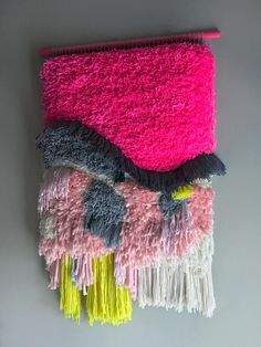 This colorful tapestry was delicately hand woven with some colorful wool and cotton threads, satin ribbons and a bunch of vintage silk cords. It was done in smoke-free home. Hand-painted and varnished wood stick in pink. It measures 26 inches width x 40 inches approximately to the longest
