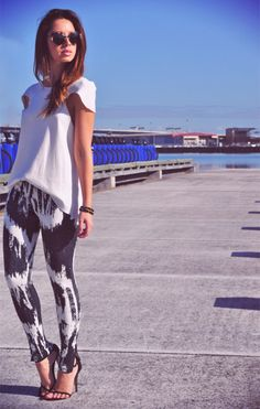 patterned pants with a solid white tee