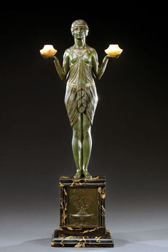 An Art Deco bronze sculpture of a young woman holding two alabaster urns, by Joseph-Emmanuel Cormier aka Joe Descomps edited by Etling Paris, circa 1925.
