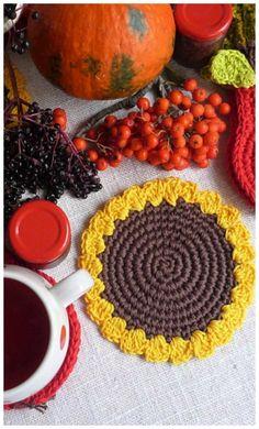 Farmhouse Fall Tablescape with Pumpkins, crochet coasters and hot tea. #falltablescape #autumndecor #crochettableware #thanksgivingdecor
