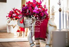 Suhaag Garden Indian Wedding, Red & Pink Flowers, Reception Centerpieces, Candelabras, Orlando Indian Wedding, Gold Glitter Sequin, Elephants