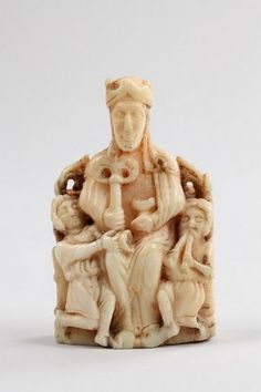 Chess piece. Seated figure of the Church,walrus ivory,North Germany or Scandinavian 13th cent. Stasteliches Museum,Berlin