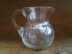 Vintage English small etched glass water lemonade juice pitcher circa 1970's Purchase in store here http://www.europeanvintageemporium.com/product/vintage-english-small-etched-glass-water-lemonade-juice-pitcher-circa-1970s/