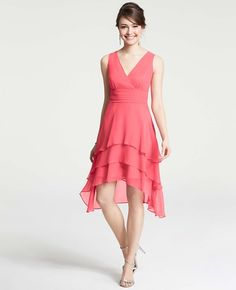 """Ann Taylor silk georgette tiered v-neck dress in Guava Juice (silk). V-neck with crossover, shirred empire waist, V-back, and tiered high-low hemline. Hidden side zipper with hook-and-eye closure. Lined. Length: 14 3/4"""" from natural waist in front; 19"""" in back. Available in petite. $265"""