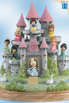 Handcrafted illuminated castle sculpture with 8 movable Precious Moments girls dressed as Disney Princess characters.