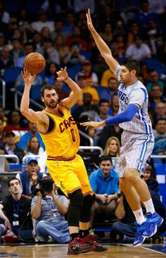 9e4db21101a Kevin Love Photos - Cleveland Cavaliers forward Kevin Love is gaurded by  Orlando Magic center Nikola Vucevic during the game at Amway Center on  December ...