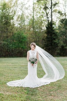 {lace wedding gown with a train and veil} http://ajdunlap.com/wake-forest-bridal-portraits/