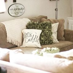 #DecorSpotting - The nurturing earthy colours of green and brown come together with clean whites for this cozy living room nook. Courtesy @homeismyhaven