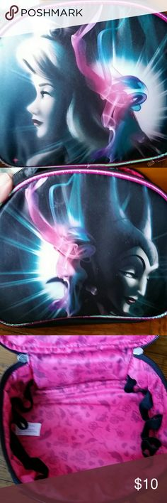 Disney good vs evil makeup case Disney good vs evil makeup case. Bought it and never used it. Has sat in my closet for about a year. It was ltd  from walgreens. Great condition. Double zipper closure. Bundle for discount. Disney Bags Cosmetic Bags & Cases