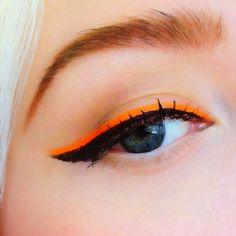 Fun orange over black liner  cool summer makeup, but I love it for fall too