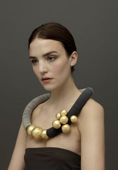 Angela O' kelly - 'Nine Gold Balls' necklace. Angela is featured at the Manchester Dazzle Exhibition 2013-14 .