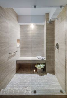 This stunning shower with an elegant neutral palette was completed by EOLO A&I DESIGN. #luxeFL