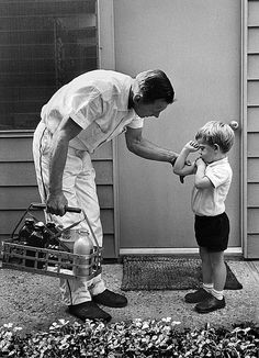 Milkman Ray checks out Christopher's muscle, Pacific Palisades, CA. 1963 by Bob Willoughby, via Flickr