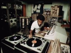 Mikey Dread during his radio show ' Dread At The Controls' in the studio of JBC (Jamaica Broadcasting Corporation) some time in the mid-seventies. Look at the mighty EMT turntables.