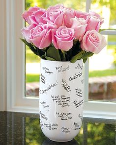 signature vase - what a good idea! You could do this with any plain ceramic vase and a ceramic marker!