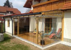 Sliding glazing for wooden structures! Would you like to glaze your existing wooden terrace with sliding walls? Then you are at the right address at Schmidinger! Check out great ideas on our website! Cedar Pergola, Steel Pergola, Pergola With Roof, Outdoor Pergola, Backyard Pergola, Modern Farmhouse Bathroom, Modern Farmhouse Exterior, Sliding Glass Door, Sliding Doors