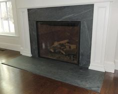 Image result for honed black granite fireplace surround