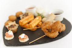 Smoked Salmon Blini with Lime & Dill Crème Fraîche, Halloumi Chips with Sweet Chilli Dip, Battered Tempura King Prawns, Parma Ham, Goats Cheese & Pesto Tartlets, Thai Crab Fishcakes with Sweet Chilli Dipping Sauce & Duck Spring Rolls.