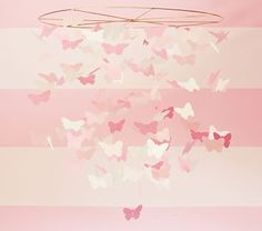 This is a cute thing to hang from the ceiling.  Pink Paper Butterfly Mobile - from Pottery Barn Kids