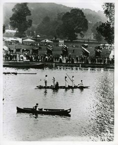 Black and white photograph showing Henley Royal Regatta circa1910-1914. The photograph shows a Thames Conservancy launch, spectators and people in boats on the river.  Copyright River and Rowing Museum.