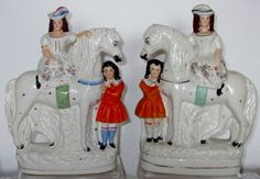 This charming Pair of Mid 19th Century Antique English Victorian Staffordshire Pottery Figure Groups of children with horses are sure to please, stirring as they do, distant happy memories of Victorian rural childhood. The two little girls, each holding a garland of flowers, sit side-saddle upon their mounts, while their young companions stand somewhat shyly below ~ applecrossantiques.com Ref. POAEVSPFGCWHH2377H2378/23