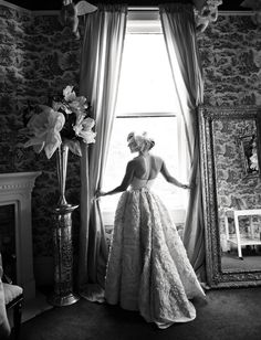 Her wedding dress was made by her mother from two old cut up wedding dresses found at thrift stores and random fabric scraps... It's amazing what some people can do with a sewing machine..