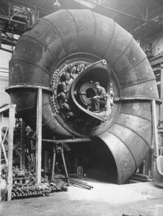 "vulturehooligan: "" c. 1930 : Building spiral turbines Curated by Amanda Uren Source: Retronaut. "" natural forms in industry"