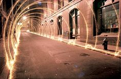 Eric Staller: Light Drawings  Using a tripod, long exposures, and various light sources (sparklers, Christmas lights wrapped around a hula hoop, etc.), He created these beautiful light drawings in New York City during the late 70′s.