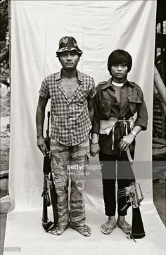 New People's Army guerillas have their portraits taken in a small mobile studio, during an operation in the north of the archipelago.