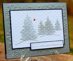 By Lisa M. Start with a card base of Night of Navy & then add a layer of Shimmery Silver that was embossed with a snowflakes folder. For the forest scene, use silver metallic ink; use the same ink for the sentiment. For just a small pop of color, use Real Red to make a Red Cardinal flying through the sky. Run the whole scene through the Cuttlebug with the Swiss Dots folder to make it seem like small snowflakes coming down.