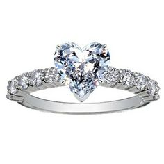 Luxe Shared Prong Diamond Ring (over 1/2 ct.tw.), set with beyond conflict free heart shaped diamond.