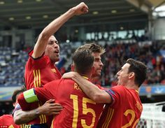 Spain's star players celebrate alongside Pique (centre) after he won the game for the reigning champions with three minutes to go