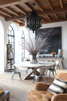 Large room, round table, metal chairs, high ceilings, chalk board, beamed ceiling